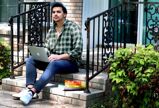 Zavior Phillips had to come back home from University of Chicago his senior year to finish up at home online. Phillips sits on his front porch on Friday, April 10, 2020, in Murfreesboro, Tenn.