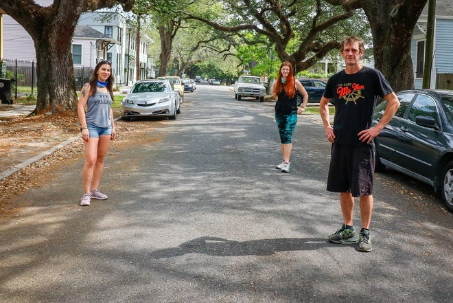 The Krewe de Greens, Raluca Giurgiutiu (left), Diana Morari (center) and Tom Levings (right), are three New Orleans restaurant workers who have been cooking to feed others who need food during the coronavirus crisis.