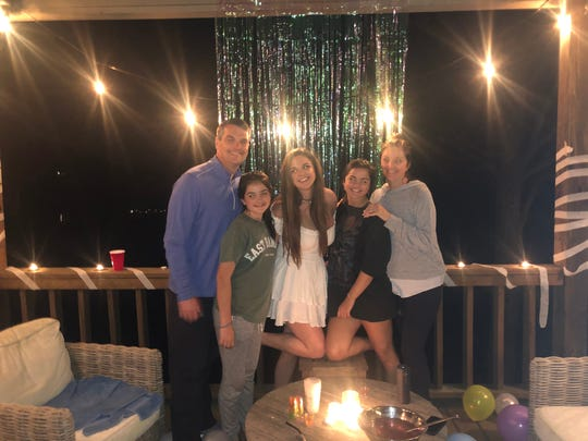 Ensworth student Mary Hayes Greer, 17, celebrated a student-led virtual prom at the lake with her family – dad Chad Greer, Caroline Greer, Mary Hayes Greer, Kate Greer and mom Kristen Greer.