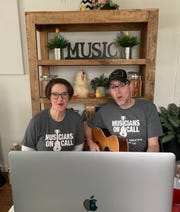 Musicians On Call volunteers Michelle and Justin Graves of Los Angeles take part in a live-stream program for patients isolated from their loved ones during the coronavirus pandemic on April 10.