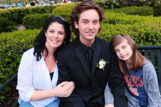 """Mom Heather and sister Lily, pose with Lebanon High School senior Alex Clemons on the day of his junior prom in April 2019. """"Happier times for sure,"""" Heather Clemons said. """"I never would've dreamed we wouldn't see his senior prom take place, much less his graduation."""" The Lebanon High prom and graduation are postponed."""