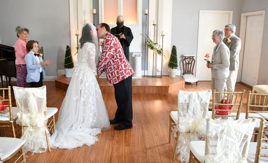 Heather Helton and Lewis Burwell had to cut their big wedding down to a small one because of the covid-19 restrictions in Donelson, Tenn. Friday, April 10, 2020.