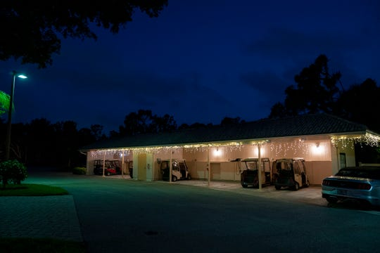 "A garage is illuminated by ""lights of hope"" organized by residents wanting to lift the spirits of their community members at Vi at Bentley Village on Thursday, April 9, 2020. Residents plan to keep the lights up until the pandemic has ended."