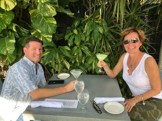Eric Rovner is enjoying a drink with him wife, Lisa. Eric runs swflfoodanddrinks on Instagram.