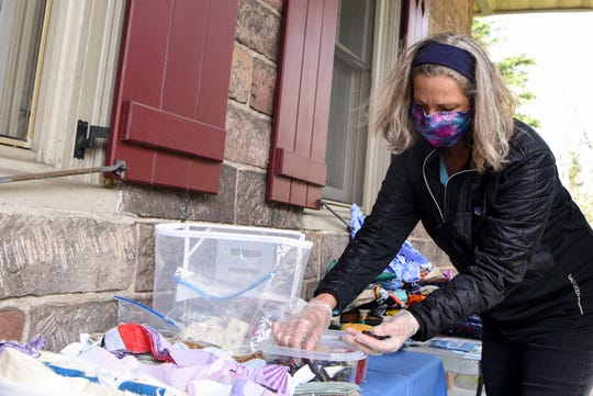 """Victoria Green sorts through donated buttons at the Bergen Mask Task Force """"hub"""" in Demarest on Friday April 10, 2020. Beidel is an active sewing volunteer and organizes southern Bergen County. Victoria Green is an active sewing volunteer and organizes western Bergen County."""