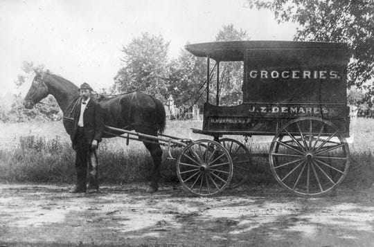 Above, the delivery truck of Bergenfield's first general store owned by John Z. Demarest. The photograph was taken about 1910. The truck went from house to house taking orders in the morning and making deliveries in the afternoon. George P. Steitz, an employee of the store, stands by the horse.