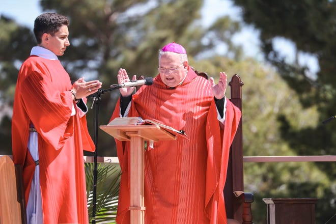 Bishop Peter Baldacchino holds Good Friday services in the parking lot of Immaculate Heart of Mary in Las Cruces on Friday, April 10, 2020.