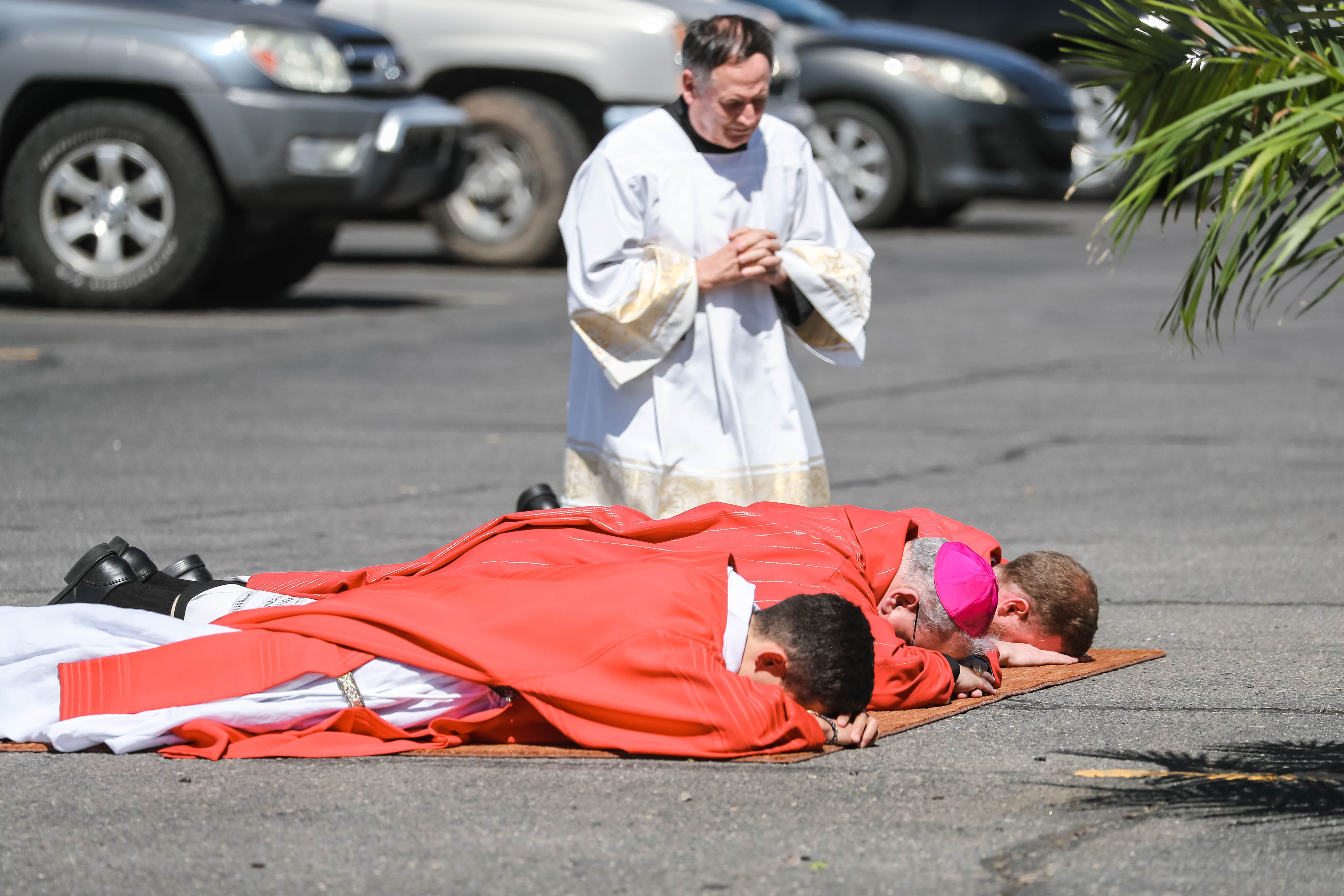 Good Friday services are held in the parking lot of Immaculate Heart of Mary in Las Cruces on Friday, April 10, 2020.