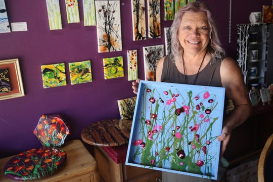 Artist Karen Ellsbury displays one of her hand-painted trays that will be featured in the Virtual Spring Art Walk presented by the Farmington Convention & Visitors Bureau beginning April 17.