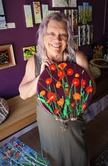 Artist Karen Ellsbury displays one of her hand-painted lazy susans that will be included in the Virtual Spring Art Walk opening April 17 through the Farmington Convention & Visitors Bureau.