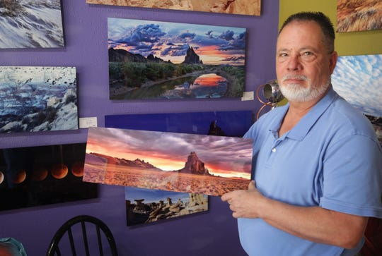 Photographer Patrick Hazen displays one of his works that will be featured in the Virtual Spring Art Walk being organized by the Farmington Convention & Visitors Bureau.