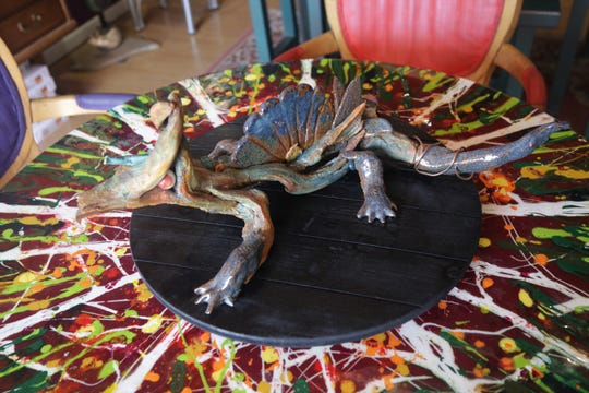 This lizard sculpture made from driftwood by Karen Ellsbury will be included in the virtual Spring Art Walk this week.