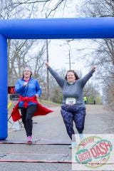 Participants celebrate finishing last year's Milford Easter Dash.