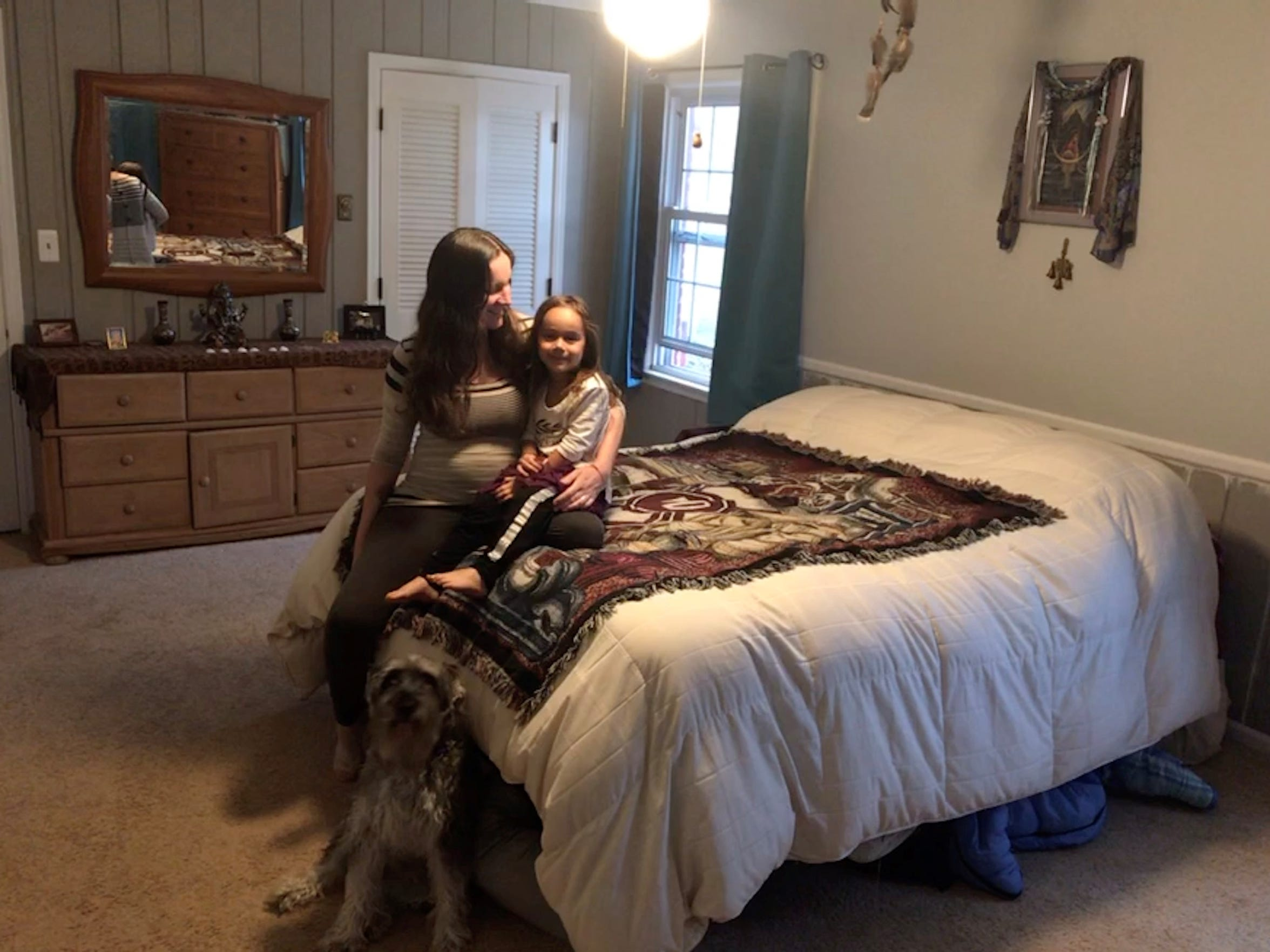 Missie Pattipati with her daughter Ayana, 4, at home in South Lyon. Pattipati hopes to protect the health of Ayana who has asthma and avoid exposure to coronavirus at the hospital by giving birth at home in July.
