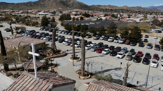 Cars lined up at Joshua Springs Calvary Chapel in Yucca Valley, Calif. for a drive-in church service.