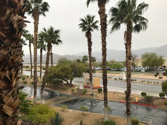 Snow-capped mountain tops are hidden behind the clouds on Friday morning, April 10, 2020, in Palm Springs, where rain continued and the Coachella Valley was on a flash flood watch until 8 p.m.