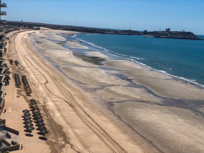 Sandy Beach, a stretch of hotels and condos popular with Arizona visitors in Puerto Peñasco, Sonora, is completely empty on April 9, 2020. The city closed the beaches, despite it being the peak of tourism season, to prevent the spread of COVID-19.