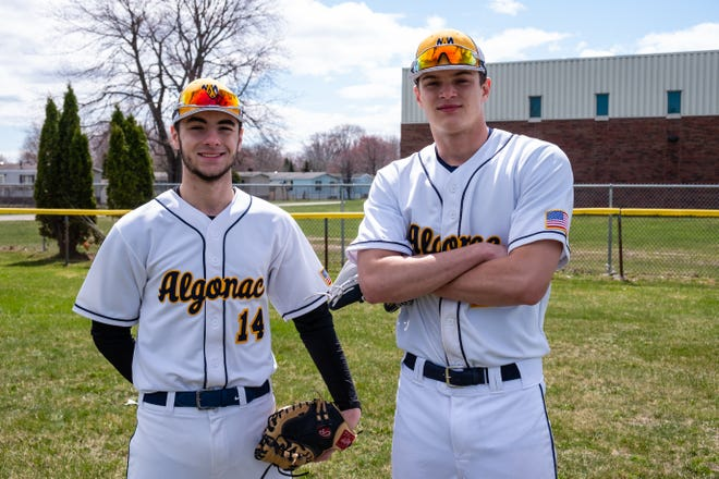 Algonac seniors Rico Taliercio, left, and Grant Stephenson phose for a photo on the school's baseball field Friday, April 10, 2020.