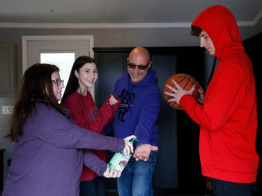 The Lofaro family, from left Maureen, Emily, Sam and Joe fool around during social distancing while at their home in Marlboro on April 10, 2020.