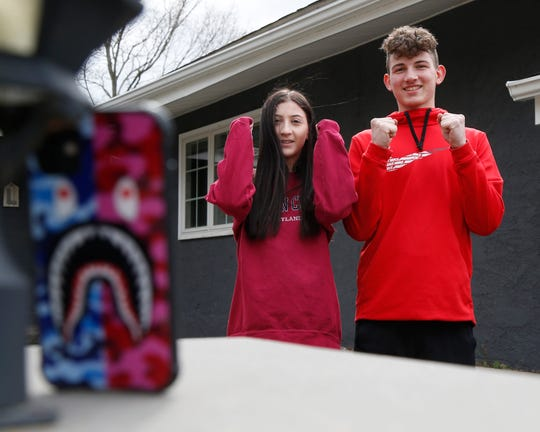 Emily and Sam Lofaro practice a routine to do on a Tik Tok video at their home in Marlboro on April 10, 2020.