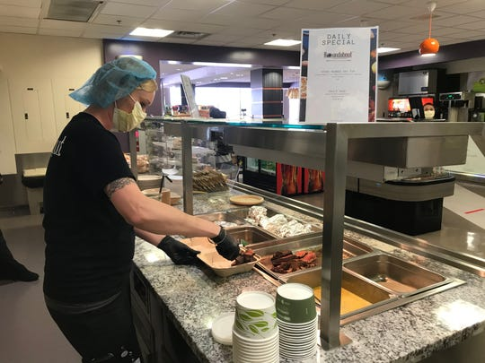 Becca Childs of Roundabout Catering of Sparks prepares strip loin with chimichurri at Sierra Café in Renown Regional Medical Center in Reno. Roundabout has been brought in to assist with employee meals as the hospital prepares for a patient surge during the coronavirus pandemic.