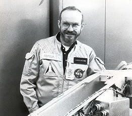 Dr. Loren Acton wearing his NASA flight jacket