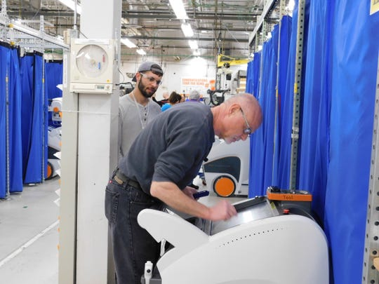 Workers at Carestream health have ramped up production of the company's DRX-Revolution mobile X-ray units due to increased demand during the coronavirus pandemic.