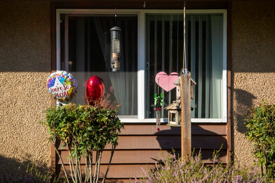 Balloons are left outside a room The Oaks at Sherwood Park nursing home in Keizer on April 9, 2020.