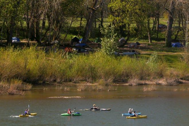 People Kayak across the Willamette River near Riverfront Park in Salem on April 9, 2020.