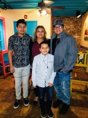 Victoria Garcia stands with her three sons, including Dani Betancourth, 10, who was diagnosed with a cancerous tumor in his brain on March 26.