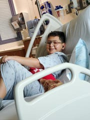 Dani Betancourth, 10, keeps smiling in his hospital bed at Dell Children's Hospital in Austin.