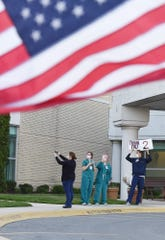 Beebe Healthcare staff show their appreciation for the first responder parade held Thursday at the campus in Lewes.