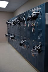 Face shields hang from lockers in 5 Layfield