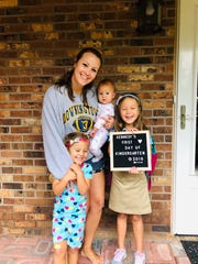 Peninsula Regional Medical Center nurse and clinical supervisor Jacqui Williams stands with her daughters (from left) Colbie, Carsyn and Kennedy — on Kennedy's first day of kindergarten in fall 2019.