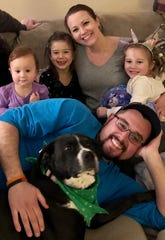Peninsula Regional Medical Center nurse and clinical supervisor Jacqui Williams and her husband Brian sit with their family (from left) Carsyn, Kennedy and Colbie. Williams now works in an active COVID-19 unit since the end of March 2020.