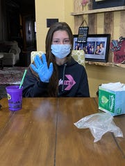 Calvary's Maddie Cory battled the coronavirus with a mask and gloves.