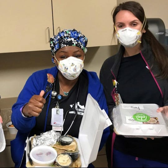 Medical workers at Willis-Knighton receive donated meals from Taziki's through 318Eats: Free the Frontline.