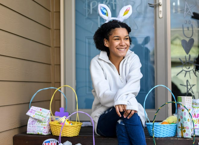 Jadyn Ramazani, 13, poses for a portrait with Easter baskets she made for nursing home residents on Thursday, April 9, 2020 at her home in Brandon S.D. Ramazani's grandfather lived at Helping Hands Assisted Living and she says many of the residents were not as fortunate as him to have a lot of visitors. She raised money and made the baskets to do something special for the residents.
