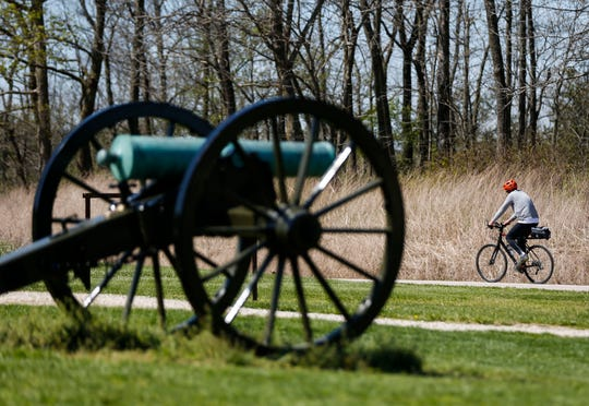 A cyclist rides his bike on the road at Wilson's Creek National Battlefield on Friday, April 10, 2020.