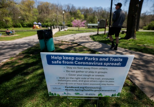 A sign at Sequiota Park reminds people of the precautions they should take to help stop the spread of the coronavirus while they visit  Springfield parks.