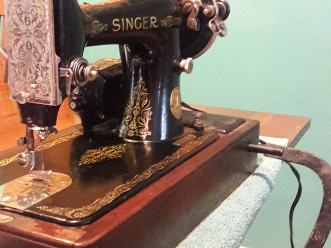 Martha Weinstein purchased the Singer sewing machine from the 1920s for $9 in 1973.