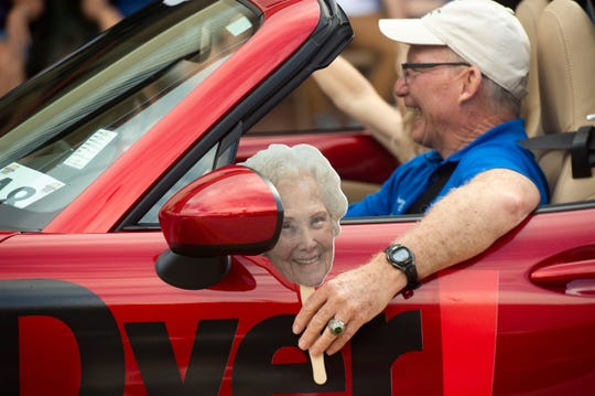 The Vero Beach Centennial Finale parade rolls down 14th Avenue on Saturday, Oct. 26, 2019, in downtown Vero Beach. Vero Beach City Councilman Tony Young (while holding a picture of Alma Lee Loy) joined about 100 businesses, schools, organizations, law enforcement agencies, churches and more who drove and marched from Vero Beach High School through downtown in celebration of Vero Beach's 100th birthday. The day-long event was cut short because of rain showers.