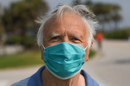 """Harry Scott, a Vero Beach winter resident from Westport, CT., wears a mask he got from a hospital. """"I had open heart surgery, high risk, and to try to reduce the spread of the virus,"""" Scott said about why he wears a mask."""