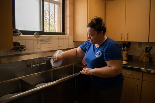Yolanda Lopez does her chores at the Villa Maria transitional living center. Lopez has been at the shelter since March 13, 2020.
