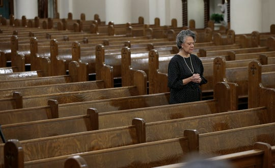 St. Patrick Cathedral Catechism leader Rosa Thorpe stands in as a parishioner between readings as Bishop Mark Seitz live streamed his Holy Thursday Mass from St. Patrick Cathedral. The mass was done via live stream to respect Coronavirus social distancing regulations.