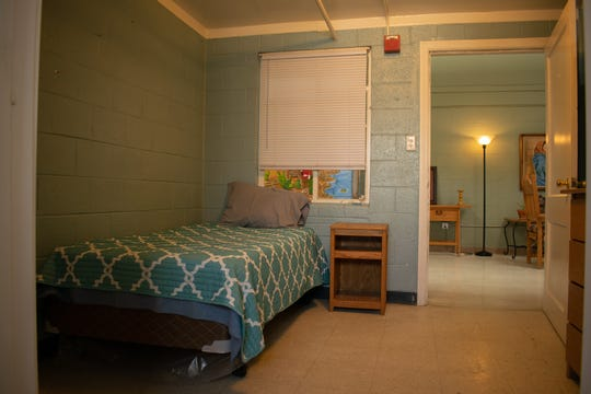 An individual room is shown at the women's shelter Villa Maria. Residents receive new bedding sets and toiletries when they arrive.