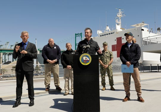 California Gov. Gavin Newsom speaks in front of the hospital ship US Naval Ship Mercy that arrived into the Port of Los Angeles on March 27.
