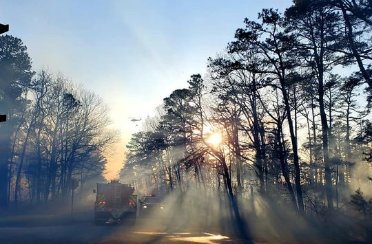 Emergency crews on scene Friday of a forest fire burning in the Millville Wildlife Management Area.