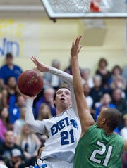 Exeter's Eli Garver shoots against Keith Datu from St. Joseph-Santa Maria on Wednesday, March 6, 2013 in a Southern California regional game.