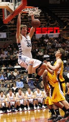 Central Valley Christian's Grant Verhoeven slam dunks against Sierra High School in the 2012 Central Section title game at Selland Arena in Fresno.